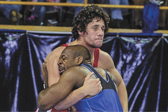 "Greco-Roman wrestler Panagiotys ""Pete"" Gounaridis, in red, believes wrestling should not be eliminated as an Olympic sport, as planned, beginning in 2020."