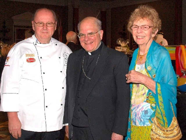 Christopher Johns, from left, Bishop Joseph Pepe and Carolyn Leontos at the Chefs for Kids gala