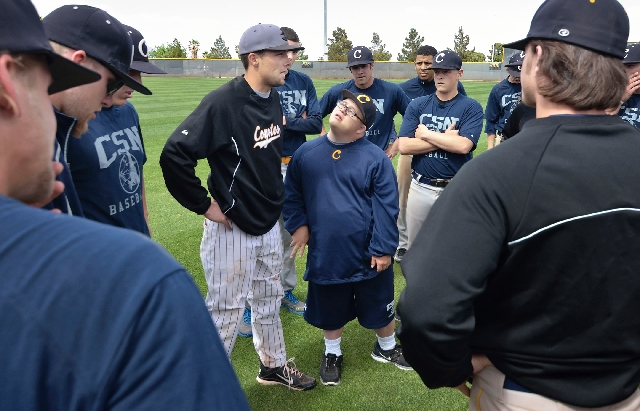 Team manager Matt Cutler, center, and College of Southern Nevada baseball players listen to assistant coach Sean Larimer during practice last week at Morse Stadium in Henderson.