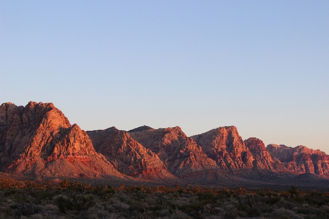 The sun rises on the Wilson Cliffs in Red Rock Canyon National Conservation Area. Many of the canyon's wonders can be seen along the Scenic Loop and at the park's many overlooks and viewpoints.