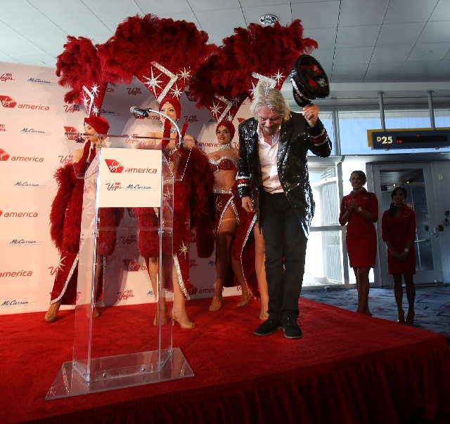 Sir Richard Branson, founder and chairman of Virgin Group, bows on Monday as he arrives at McCarran International Airport on Virgin America Airlines' inaugural flight from Los Angeles to Las Vegas.