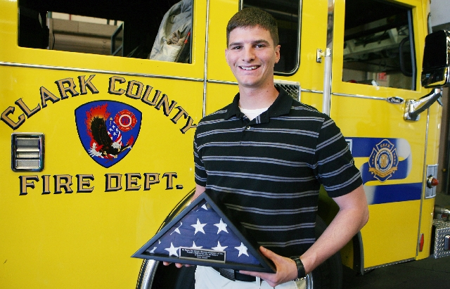 Navy Corpsman Francis Boecker, a sailor with 1st Battalion, 7th Marine Regiment, holds a flag he presented Tuesday to the Clark County Fire Department's Station No. 18, 575 E. Flamingo Road. Boeck ...