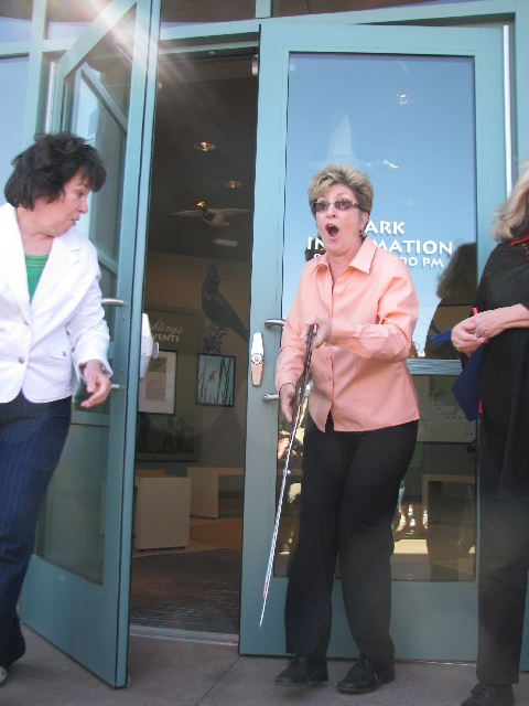 Commissioner Chris Giunchigliani gets booted by an automatic door that suddenly opened during the April 20 ribbon cutting for the Nature Center at Clark County Wetlands Park. Perhaps she should ha ...