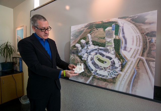 Windom Kimsey, president of architect firm Tate Snyder Kimsey, shows the China-based CXTX International Auto City project renderings at his Henderson office on Tuesday.