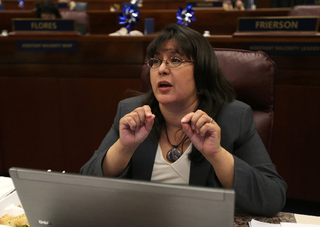 Assemblywoman Irene Bustamante Adams, D-Las Vegas, talks on the Assembly floor Tuesday before legislators approved the proposal to raise the sales tax in Clark County to 8.25 percent.