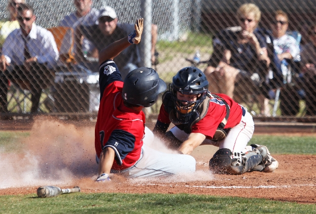 Carmen DiGennaro slides under Liberty catcher Joe Maurer's tag to score on Mike Maiello's fifth-inning single Tuesday in Coronado's 3-1 win. Maiello also had an RBI single in the first.