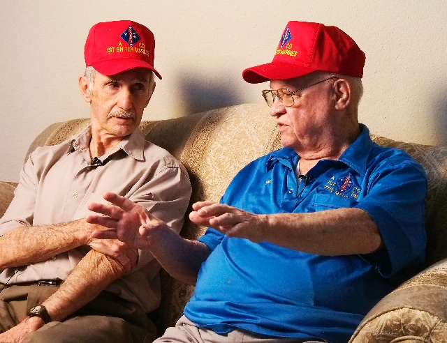 Vito Tomasino, left, and Donald Powell talk about their experiences as Marines in Korea at Tomasino's home Wednesday in Las Vegas.
