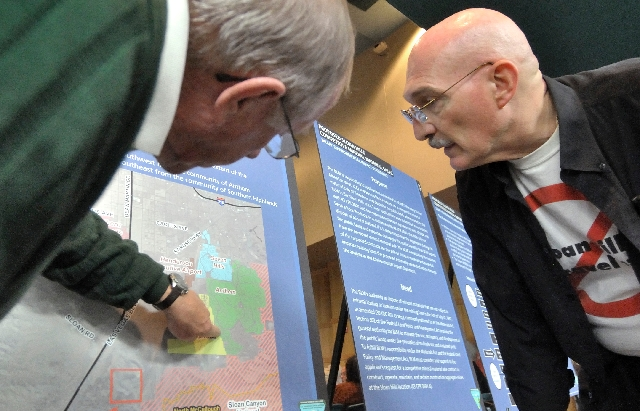 Sun City Anthem residents Paul MacDowell, left, and Frank Blaha check out a map of a proposed Sloan Hills mining site prior to a public meeting hosted by the Bureau of Land Management on Nov. 2, 2 ...