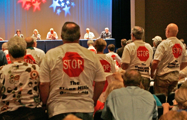 A group of Henderson and Sun City Anthem Residents wear Stop The Sloan Hills Gravel Pit T-shirts during a public forum at Sun City Anthem on April 3, 2009. The CEMEX and Service Rock company have  ...