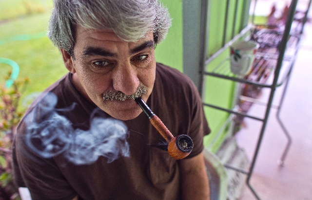 James Flavy Coy Brown, 48, is addicted to smoking his pipe and asks over and over for more tobacco as he waits for his morning medicine to be delivered. When this photo was taken on April 4, he wa ...