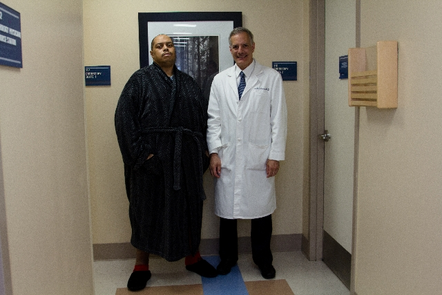 Wesley Warren Jr., left, is shown with Dr. Joel Gelman, who led a team of surgeons and nurses in correcting an abnormality that Warren endured for five years.