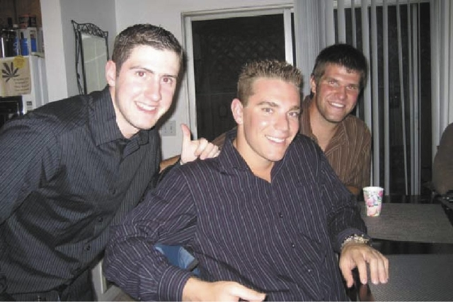Matt Roth, center, poses with friends in an undated photo. Roth, a professional poker player, committed suicide in Las Vegas on Tuesday, April 23, 2013.