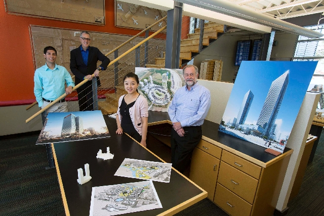 The team of, from left, Christopher Lujan, Windom Kimsey, Wendy Sun and Robert Boyle of Tate Snyder Kimsey show renderings of work created for projects in China. The company established a sales an ...