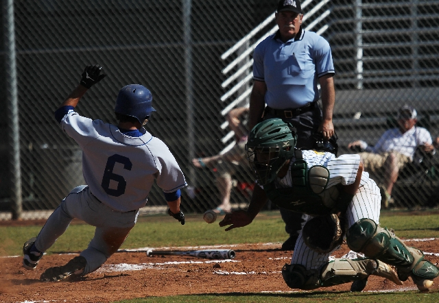 Sierra Vista's Cole Crosby (6) slides home safely as the relay eludes Rancho catcher Chris Fitzpatrick on Friday at Rancho. Crosby finished 3-for-4 and scored three runs to help the Mountain Lions ...