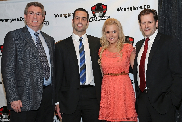 "New Wranglers coach/general manager Mike Madill, second from left, is shown Friday with wife Autumn, team owner Gary Jacobs, left, and president Billy Johnson. ""Mike's a great communicator,"" Jacob ..."