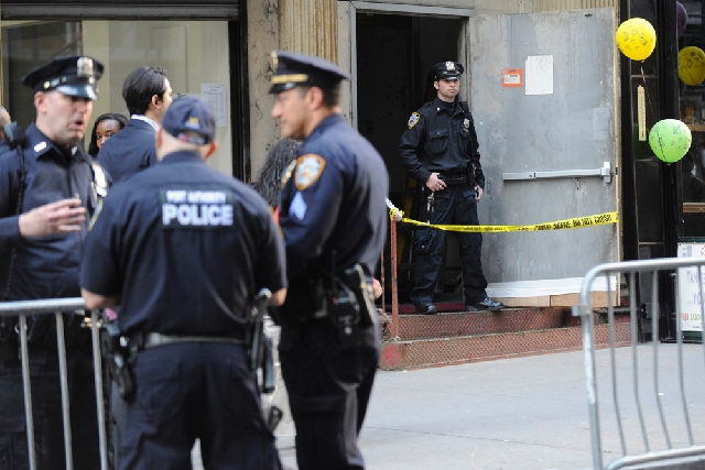 The entrance of 51 Park Place is cordoned off by police on Friday in New York. A part of a landing gear, apparently from one of the commercial airliners destroyed on September 11, 2001, has been d ...