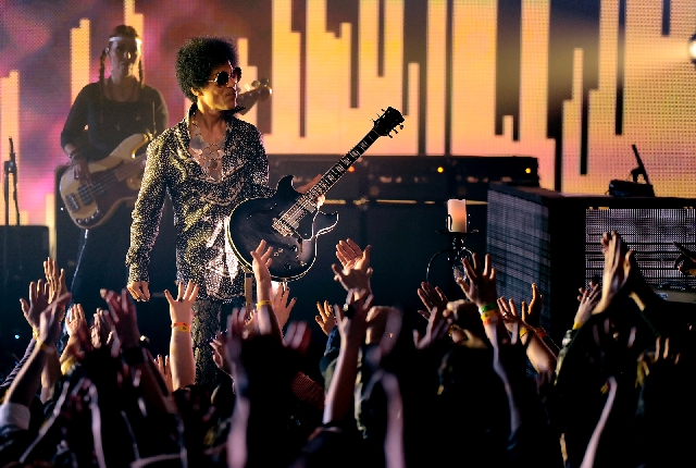 Prince and 3rd Eye Girl perform April 15 in Vancouver, British Columbia.