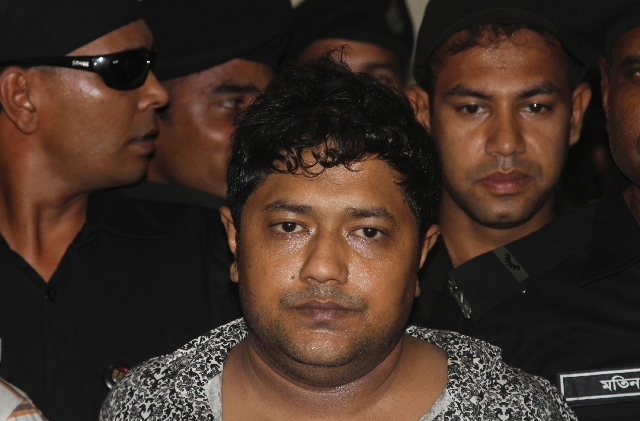 Mohammed Sohel Rana, the fugitive owner of an illegally-constructed building that collapsed last week in Bangladesh, is produced before the media by Rapid Action Battalion commandoes in Dhaka, Ban ...