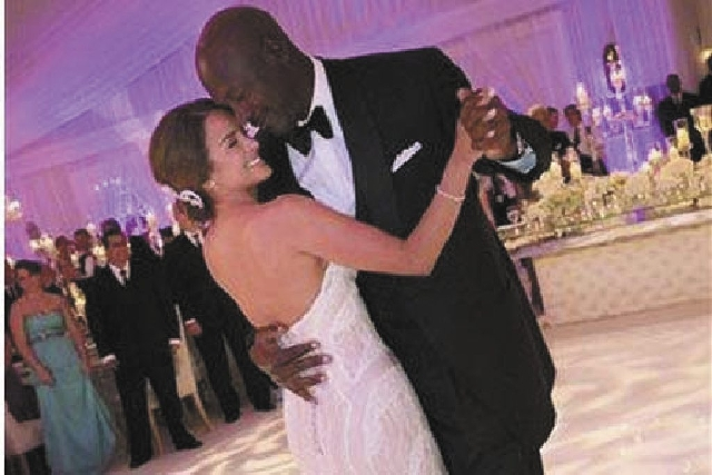Charlotte Bobcats owner Michael Jordan dances with his bride Yvette Preto during thier wedding reception at the Bear's Club in Jupiter, Fla.