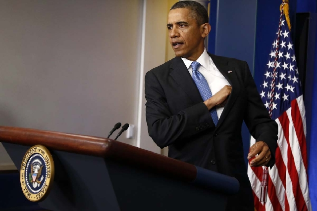 President Barack Obama arrives for a news conference in the Brady Press Briefing Room of the White House in Washington on Tuesday.