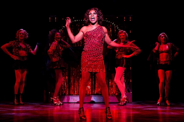 "This theater image released by The O+M Company shows Billy Porter during a performance of ""Kinky Boots."" The Cyndi Lauper-scored ""Kinky Boots"" has earned a leading 13 Tony Award nominations on Tue ..."