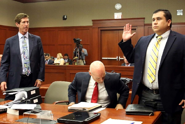 Defendant George Zimmerman, accused in the killing of Trayvon Martin, is sworn in for testimony in Seminole circuit court, in Sanford, Fla., with his attorneys Mark O'Mara, far left, and Don West  ...