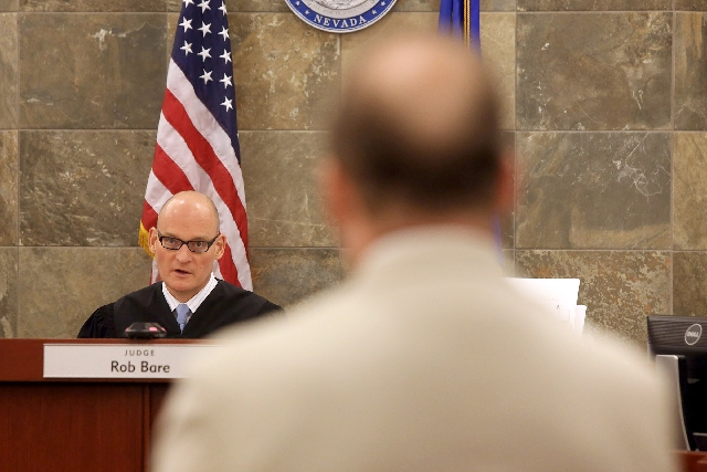 Attorney Kenneth Frizzell, right, representing Las Vegas Township Constable John Bonaventura stands while District Court  Judge Rob Bare speaks on Tuesday at the Clark County Regional Center. Bare ...