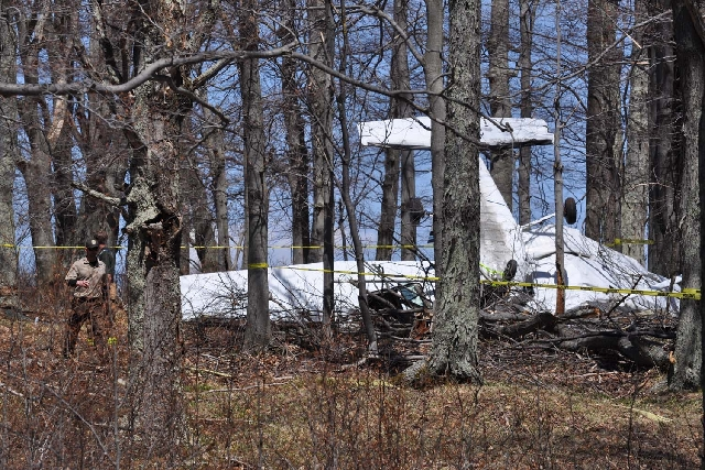 Authorities investigate the scene of a crash of a small plane carrying three people on board Friday, April 26, 2013 near Davis, W.Va. Tucker County emergency services spokesman Chris Stadelman say ...