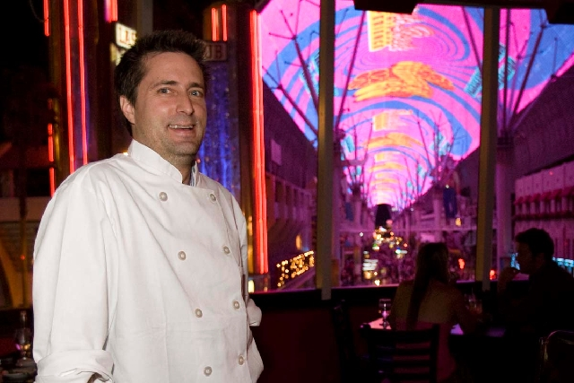 Firefly restaurant owner and chef John Simmons, owner of the Firefly Tapas Kitchen and Bar on Paradise Road, says his restaurant follows health district policies. The restaurant remains closed whi ...