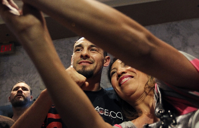 Boxer Robert Guerrero takes a photo with a fan after arriving at the MGM Grand in Las Vegas on Tuesday.