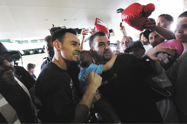 Boxer Robert Guerrero, left, takes photos with his fans after arriving at the MGM Grand in Las Vegas on Tuesday.