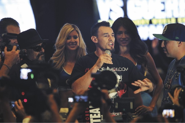 Boxer Robert Guerrero speaks to the crowd after arriving at the MGM Grand in Las Vegas on Tuesday.