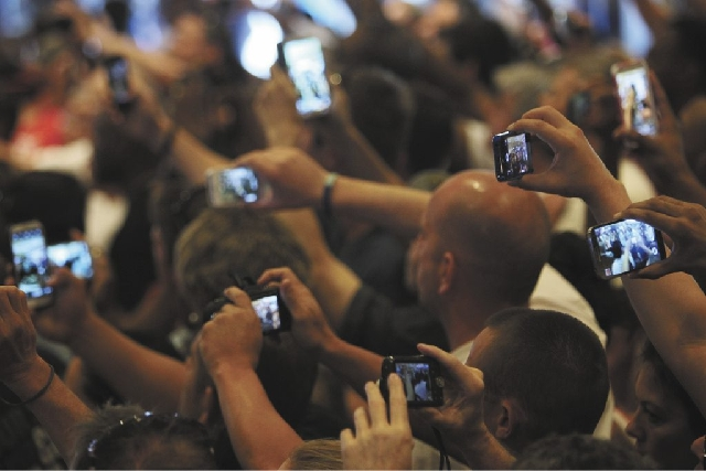 Fans record the event as boxers Floyd Mayweather Jr. and Robert Guerrero arrive at the MGM Grand in Las Vegas on Tuesday.