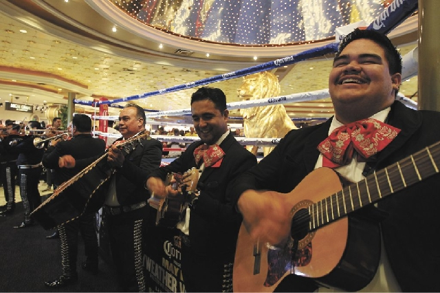 Mariachi Colima performs as boxers Floyd Mayweather Jr. and Robert Guerrero arrive at the MGM Grand in Las Vegas on Tuesday