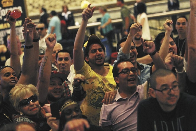 Fans cheer as boxers Floyd Mayweather Jr. and Robert Guerrero arrive at the MGM Grand in Las Vegas on Tuesday.