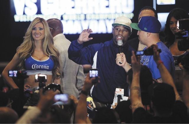 Boxer Floyd Mayweather Jr. speaks to the crowd after arriving at the MGM Grand on Tuesday.