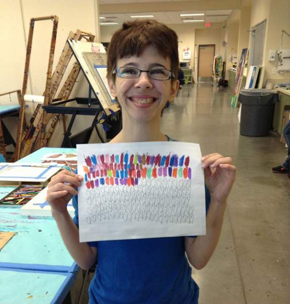 Amanda, an Opportunity Village client,proudly showcasesthe first stage of her latest piece of art. Opportunity Village's enrichment program incorporates visual arts, music, dance and ...