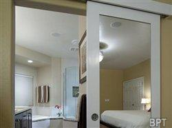 Wall-mounted sliding door 'reflects' a genius design solution