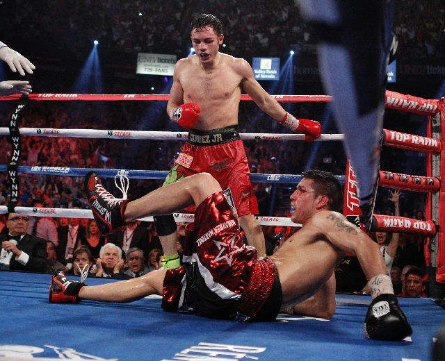 Julio Cesar Chavez Jr. knocks down Sergio Martinez in the 12th round of their WBC Middleweight Title fight at the Thomas & Mack Center in Las Vegas Saturday, Sept. 15, 2012.