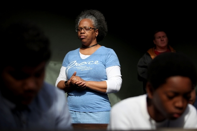 Melanie Winckler, wife of Pastor Dan Winckler , prays during a Feb. 2 service at Casa de Luz church in Las Vegas. Melanie was a prostitute for years and was pimped in several states. She says she  ...