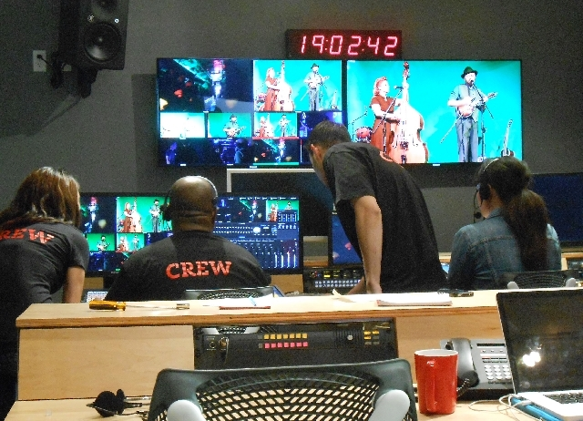 Crew members at Fremont East Studio, 221 Las Vegas Blvd. North, stream a live video recording of an in-studio performance by local band The All Togethers during the studio's April 9 opening ceremo ...