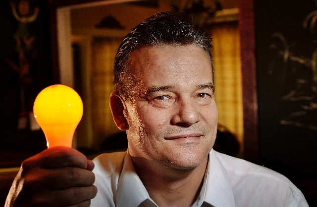 """Russell Millar, owner of Official Las Vegas Light, shows a used bulb from the famous """"Welcome to Fabulous Las Vegas"""" sign at his home near Boulder Highway and Horizon Drive."""