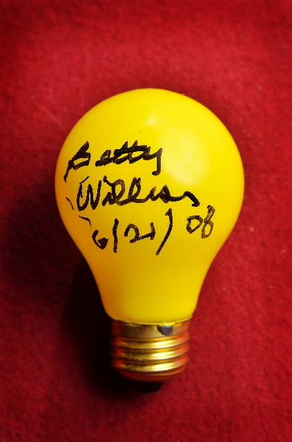 """Betty Willis, who designed the """"Welcome to Fabulous Las Vegas Nevada"""" sign in the late 1950s, signed this used bulb from the sign."""