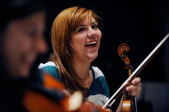 Alondra De La Rosa smiles during a break at a rehearsal of the mariachi ensemble class at the College of Southern Nevada, Cheyenne campus.