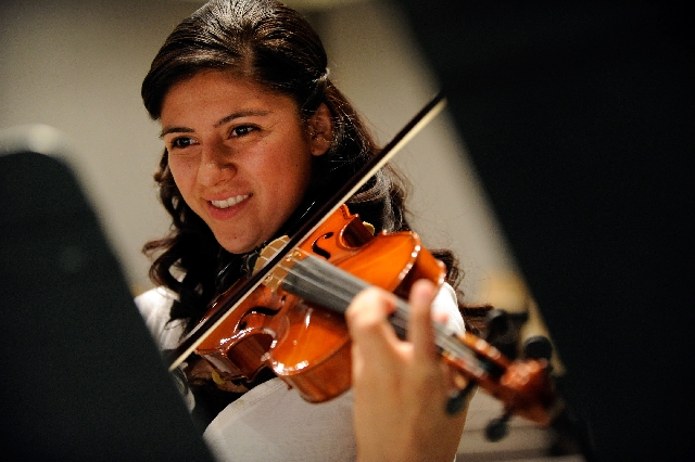 Krystal Reyes plays her violin in the mariachi ensemble class.