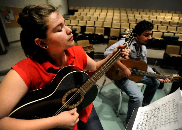 Karla Avila, left and Federico Mendez play their guitars during a rehearsal of the mariachi ensemble class at the College of Southern Nevada. The group is scheduled for a semester-end concert Tues ...