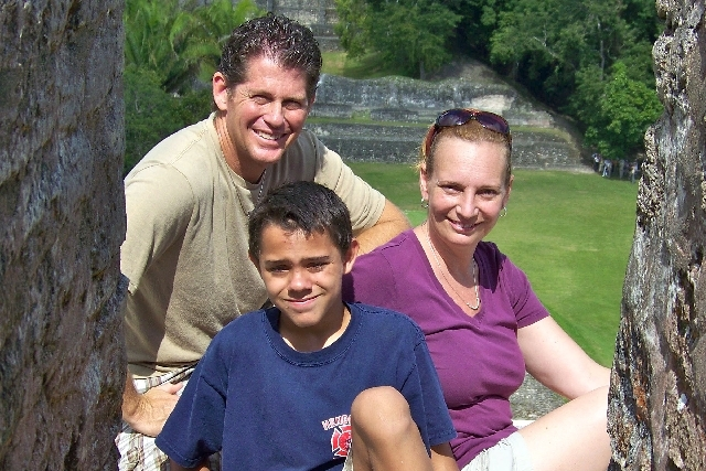 Michael, Colin and Amanda Cyphers sit atop the Xunantunich ruins, about six miles from near their home in San Ignacio, Belize.