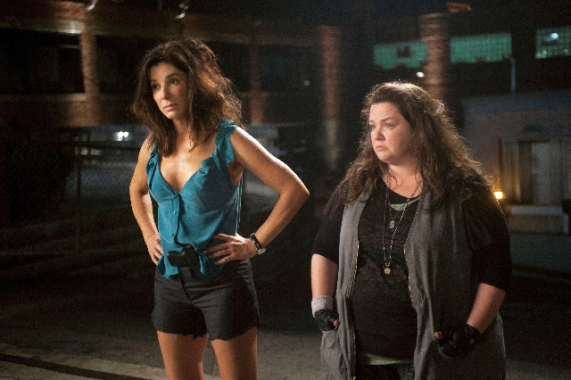 """From left, Sandra Bullock and Melissa McCarthy play mismatched investigators in the caper comedy """"The Heat."""""""
