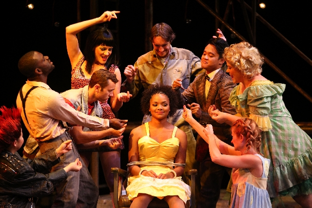 """Jade Payton as Hope Cladwell, center, sits tied in a chair during the group number """"Snuff That Girl"""" during a Nevada Conservatory Theatre dress rehearsal of """"Urinetown."""""""