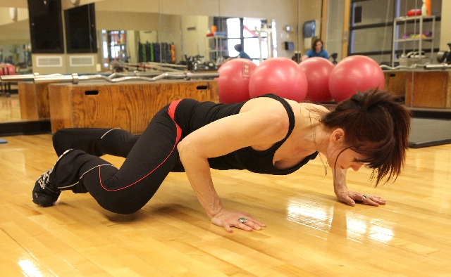 From the starting position, perform a pushup, keeping the elbow of the lower hand in toward the ribs. At the top, crawl forward by moving the lower hand forward in front of the other hand and the  ...